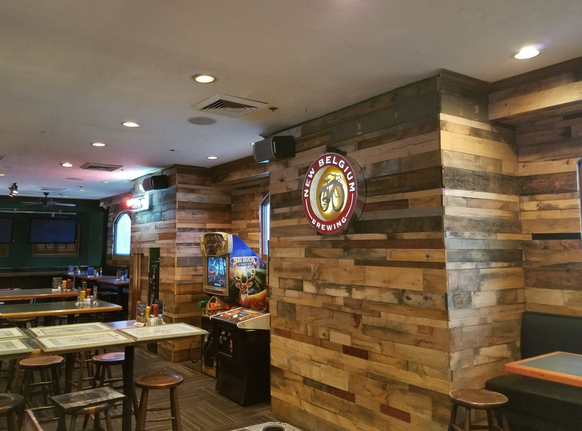 Custom reclaimed wood wall feature in bar mission hardwood for Local reclaimed wood